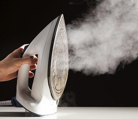 Come pulire il ferro da stiro a vapore dal calcare - Monclick